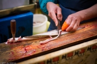 "Worker filleting a saltwater eel (""anago""), Tsukiji Fish Market"