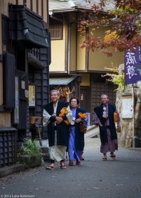 Japanese spa tourists in yukata robes, Kurokawa