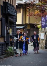Japanese spa tourists in yukata robes, Kurokawa