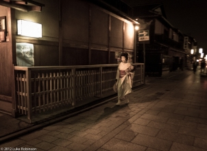 Geisha hurries through Gion, Kyoto