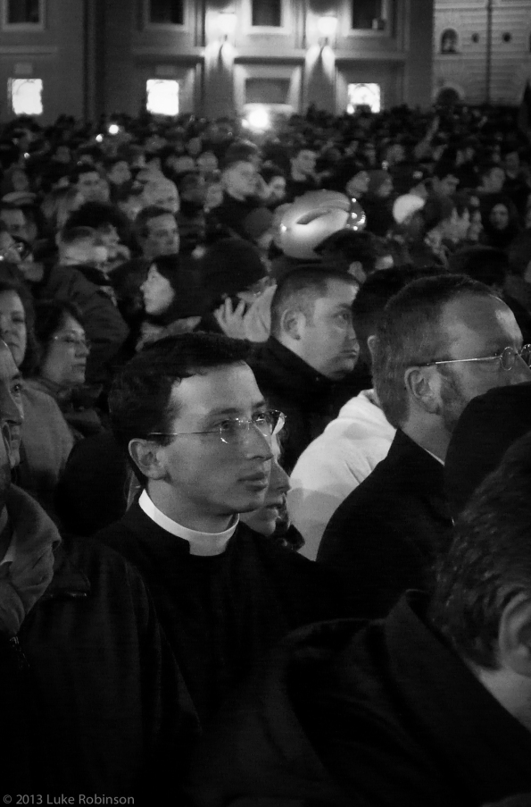 Catholic Priest listens to the first address of Pope Francis